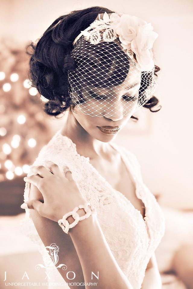 Sepia portrait of young bride wearing a flower topped birdcage veil in the bridal suite at the Carl House in Auburn GA