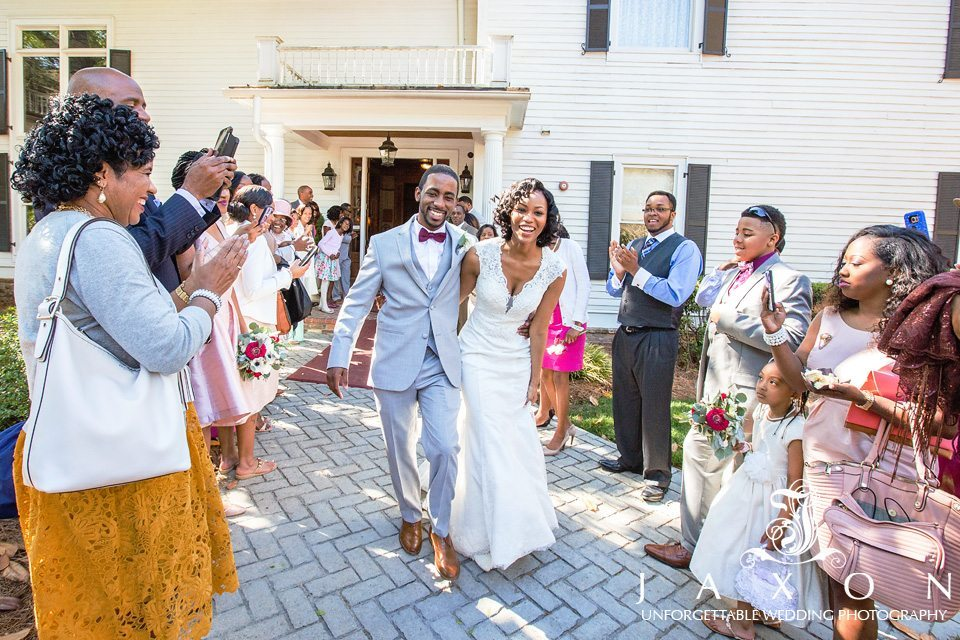 At the end of their Carl House Wedding, the couple embraced each other as the walked between two lines of their cheering guests