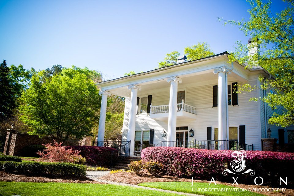 White four column exterior of the Carl House in Auburn GA, with two of it chimneys visible