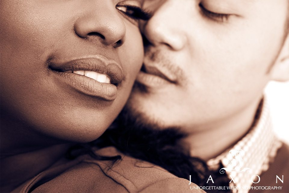 Closeup Sepia Toned image of couple as they kiss