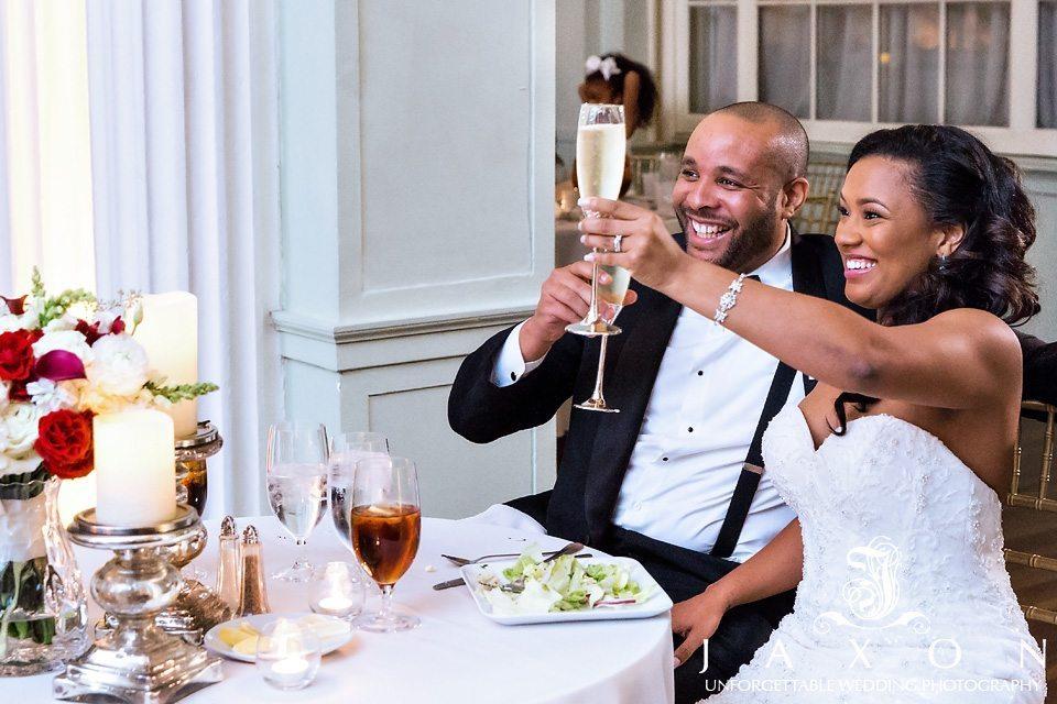 Smiling couple, raise their Champaign flutes to toast their Biltmore Atlanta wedding.