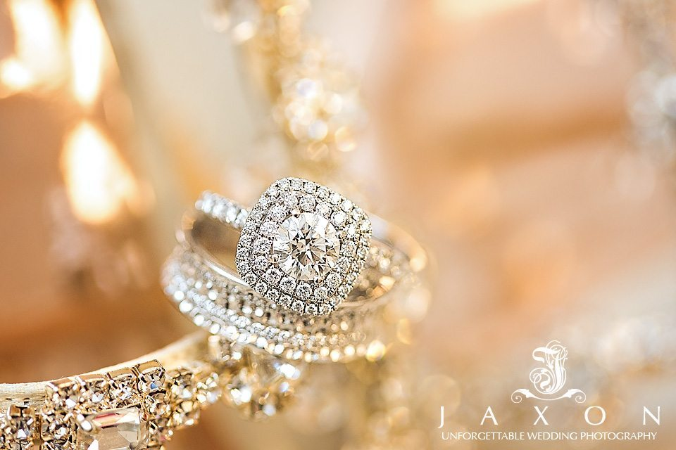 engagement ring and grooms wedding band on brides rhinestone encrusted shoe strap
