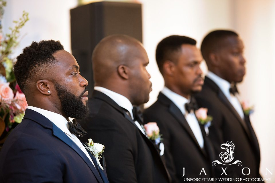 Groom focuses on his bride as she enters wedding ceremony
