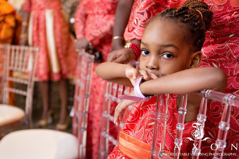 Little girl in brightly colored dress looks at camera