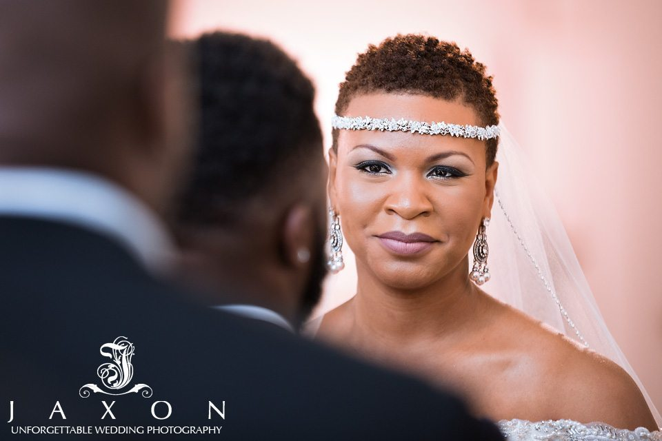 Bride focuses on her groom as re says his vows