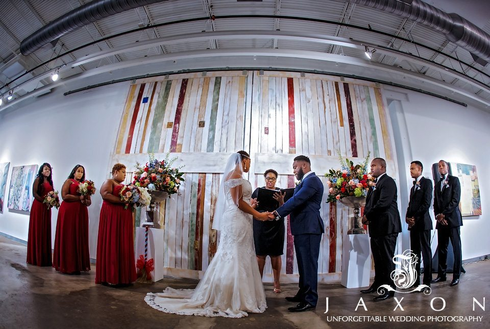 Wedding ceremony takes place in front floor to ceiling multi colored doors at Mason Fine Art