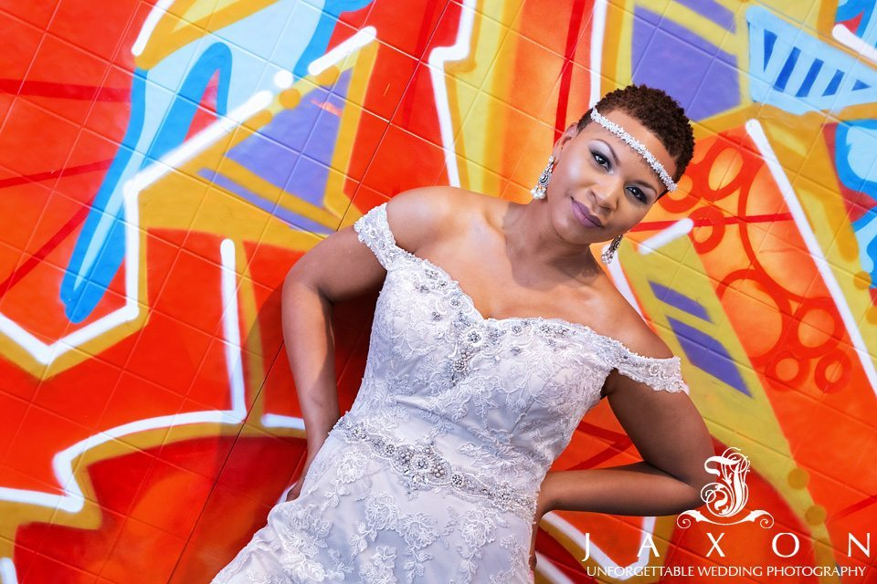 Bride strike a pose on one of the colorful walls at Mason fine Art
