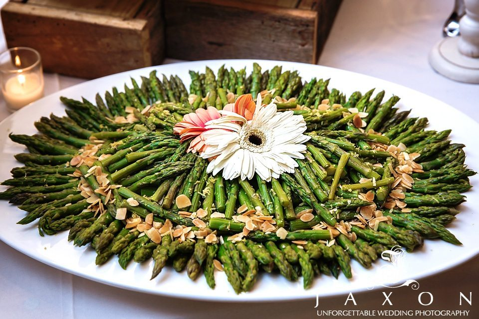 Asparagus dish accented with roasted almonds around a center flower