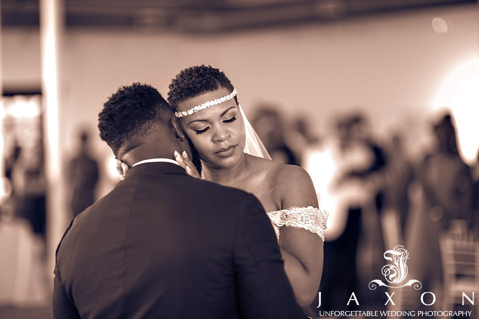 Bride and groom lock in a tender embrace as she cups his face