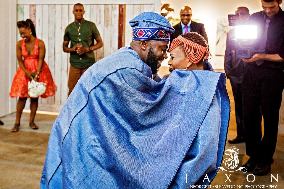 Couple dance in traditional Nigerian wedding attire
