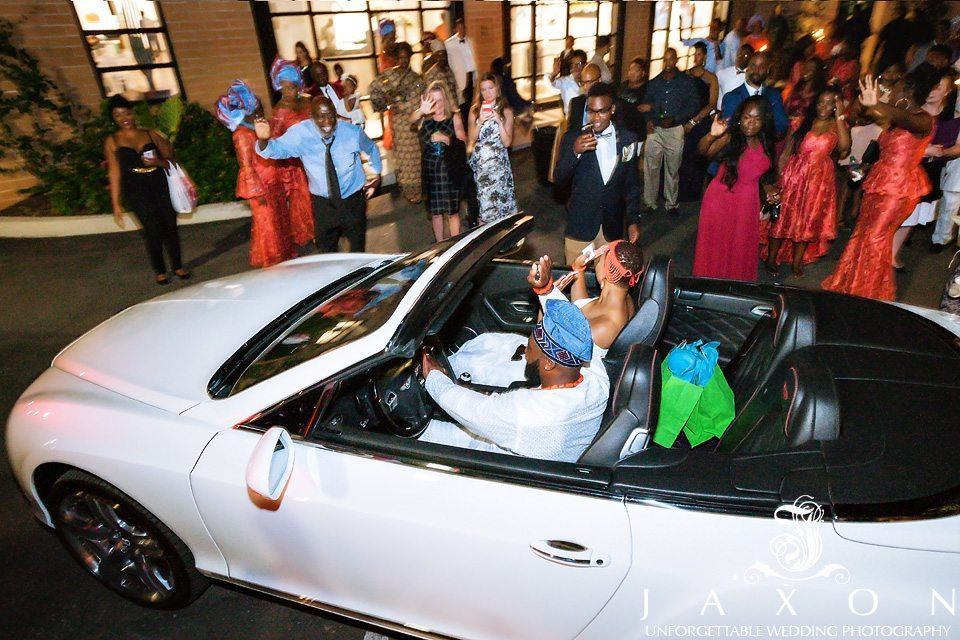 Couple leaves in white Bentley continental coup