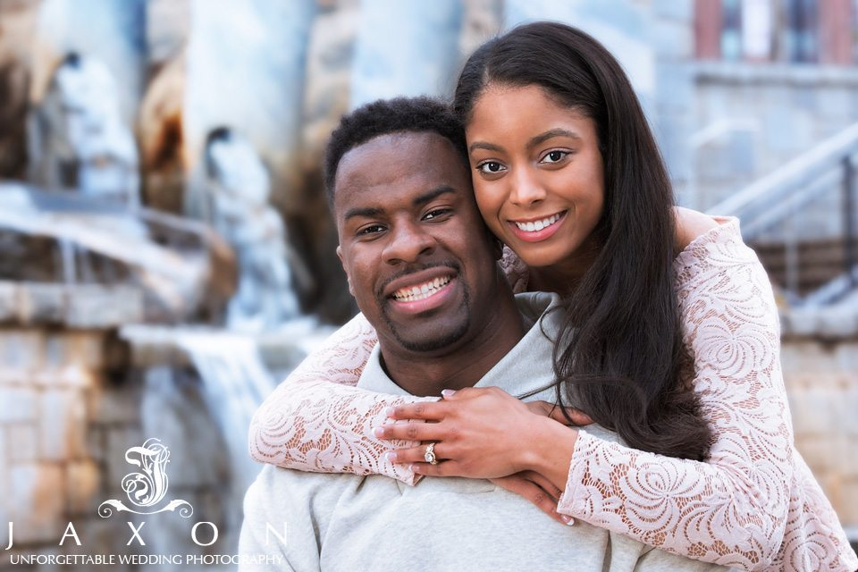 Couple in-fort of the waterfall feature at Old Fourth Ward engagement