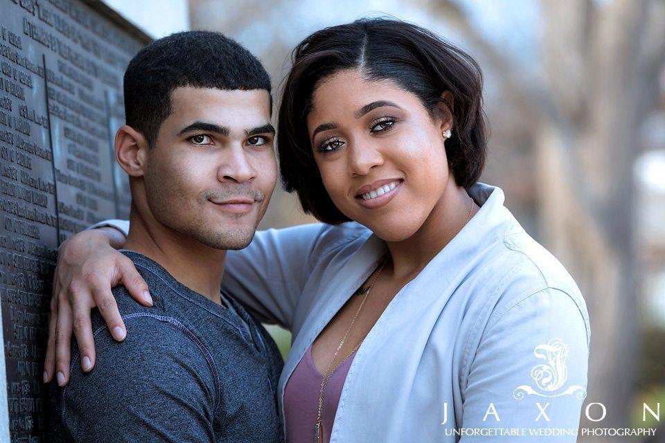 Couple embracing and looking at camera