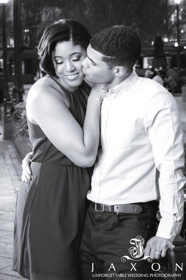 B&W portrait of couple embracing at Woodruff Park Atlanta at night