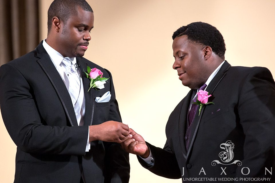 Best man hands the groom the wedding ring during the wedding ceremony at ATLANTA NORTH SEVENTH-DAY ADVENTIST CHURCH