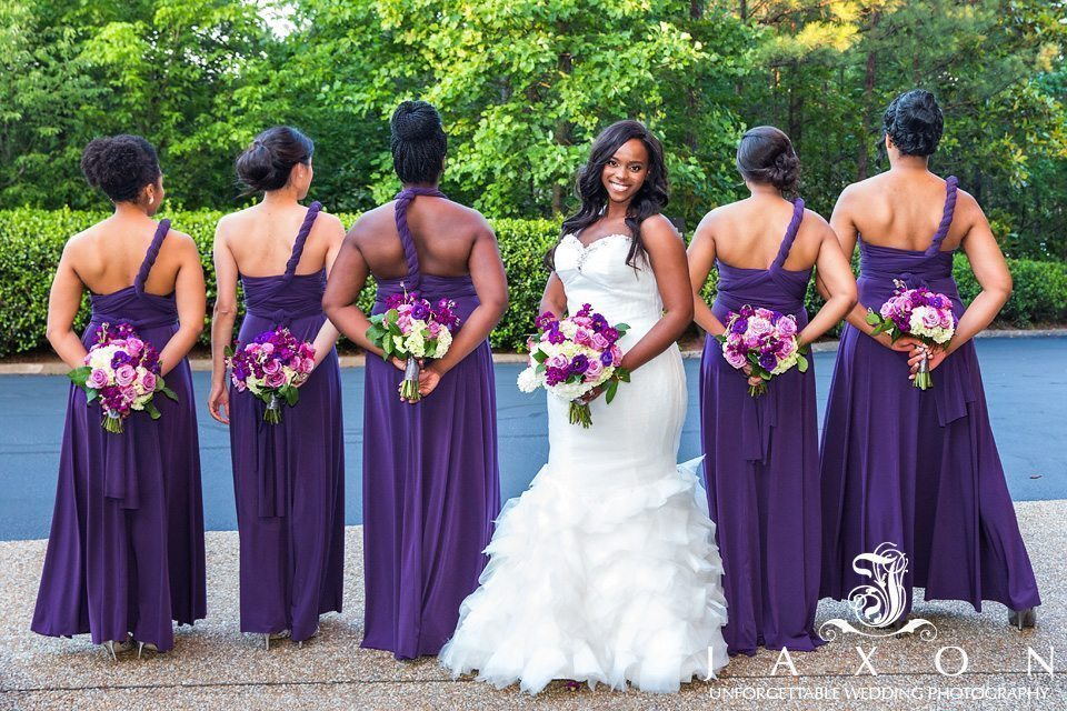 Bridesmaids showing off the back of their Mori Lee Style 712 plum colored convertible dresses at the Doubletree Roswell Wedding