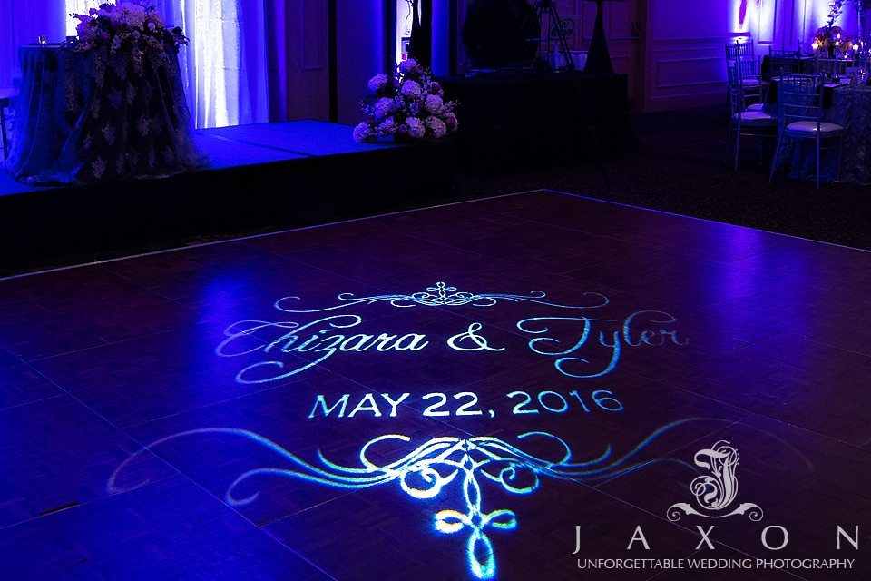 Couple's names and wedding sate projected on dance floor