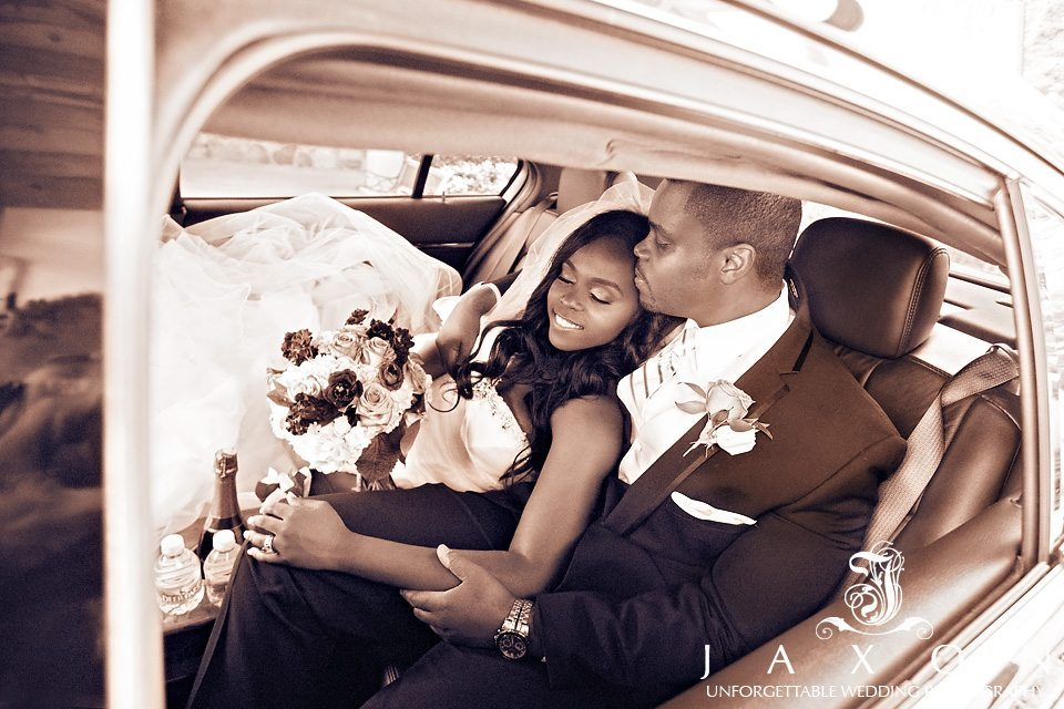 Sepia portrait of couple in the back of their limo at the end of a long day