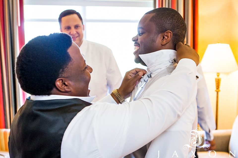 Groom being helped by his attendants before his DoubleTree Roswell Wedding