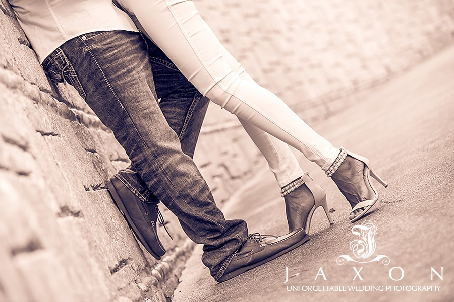 Sepia image of embracing couple's feet