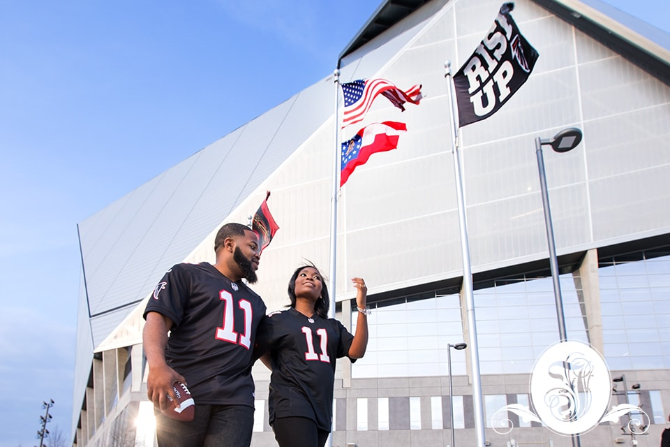 Engaged couple wearing the #11 Falcons jersey