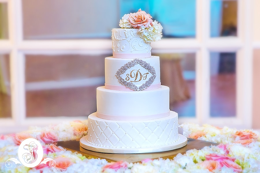 four-tiered round wedding cake