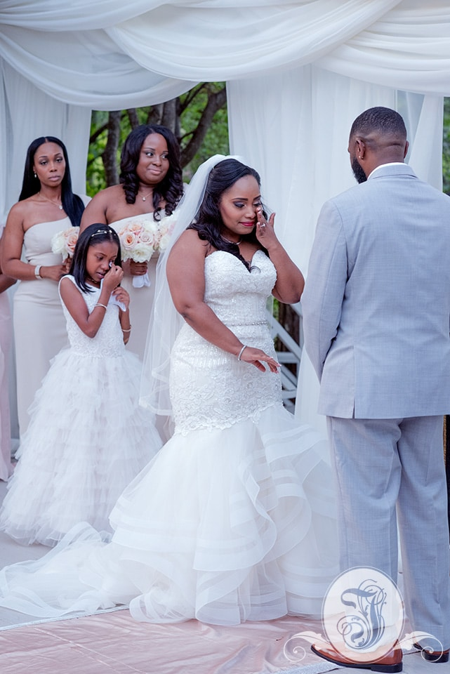Emotional bride and daughter during vows