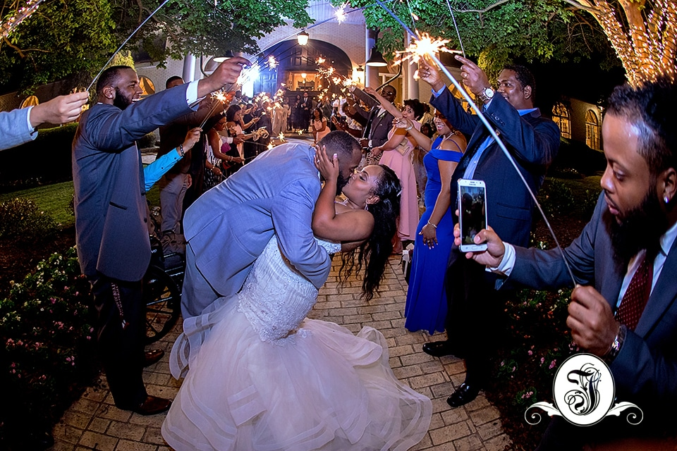 One last kiss as bride and groom exits their Vines Mansion Wedding