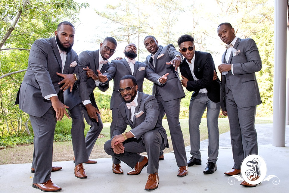grooms men celebrate